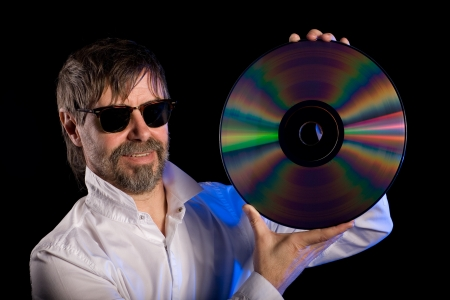 Lover of music with the retro laser disc. photo
