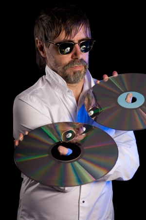 Man holds a retro laser discs on a black background. photo