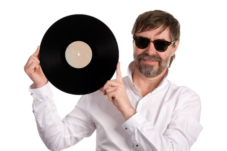Music lover with an old vinyl disc isolated on white. Stock Photo - 13871742