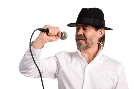 Portrait of a singer with a microphone in a black hat photo