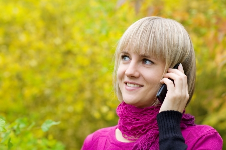 Beautiful young woman talking on a mobile phone. photo