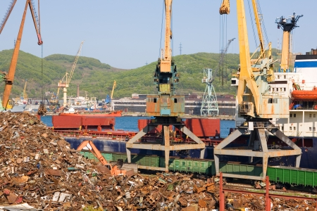 Recycling, loading scrap metal in the ship. Russia. Port of Nakhodka. Primorskiy Kray. photo
