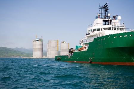 Ocean tug towing base offshore oil drilling platform  Sea of Japan  Russian coast  photo
