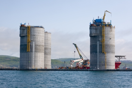 towed: Base of the oil drilling platform towed to the area of production