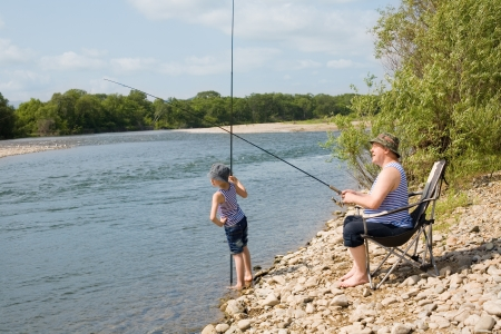 Grandfather and grandson go fishing on weekends. photo