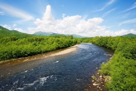 River summer landscape with bright blue sky and clouds  photo