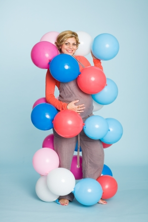 Joyful pregnant woman with balloons  photo