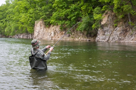 Fisherman pulls caught salmon from the river Stock Photo - 17750711