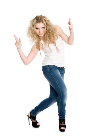 Slim young blond girl dancing hip hop. photo