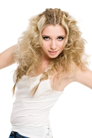 Young beautiful girl with blond curly hair and stylish make-up.  photo