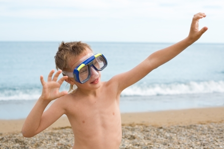 Boy trains in a mask for a scuba diving photo