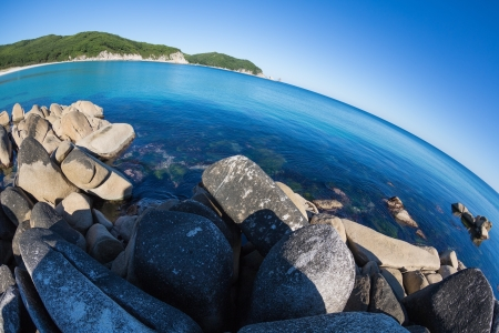 Summer landscape of sea coast. Japan sea. Fish-eye lens. photo