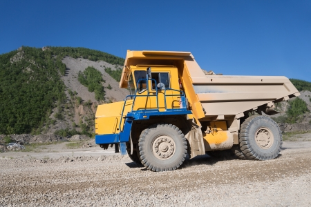 mining truck: Heavy mining truck driving through the iron ore opencast