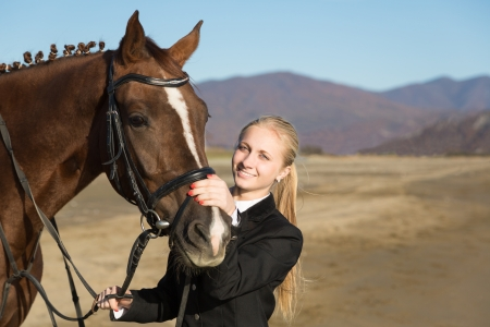 Happy girl teenager with his horse  Autumn  photo