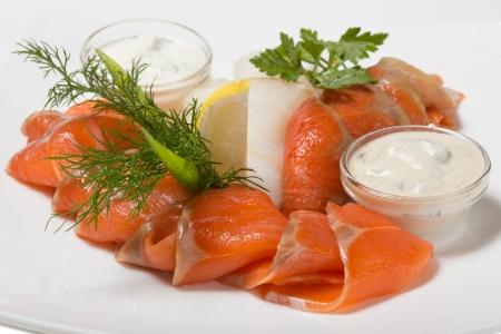 Cold appetizer of smoked halibut, salted trout, sockeye salmon salting cognac with lemon cream mushroom sauce.