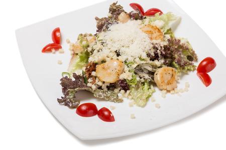 Black Caesar salad with scallops and cherry tomato. photo