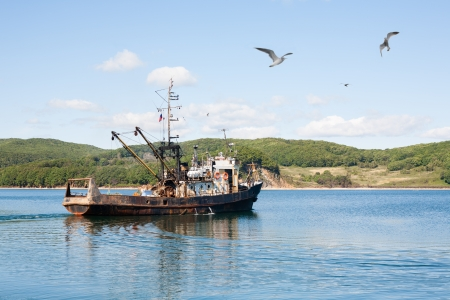 Fishing ship out to sea to fish. photo