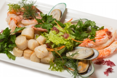Assorted sea scallops, crab, mussels, tiger shrimp and lettuce. photo