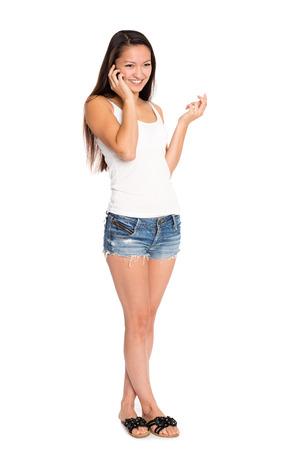 mixed race woman: Smiling asian young woman talking on the phone. Mixed race Asian Caucasian girl.
