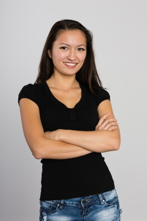 Beautiful smiling Asian young woman. Mixed race Asian Caucasian girl. photo