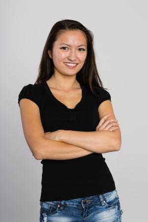 Beautiful smiling Asian young woman. Mixed race Asian Caucasian girl. Stock Photo - 23575749