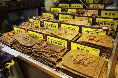 absent: Traditional Asian food of beef jerky and pork in the shop of Macau, China  Trademarks are absent  Stock Photo