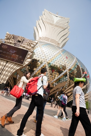 lisboa: MACAU, CHINA - NOVEMBER 2, 2012  Tourists at the Grand Lisboa Casino - one of the largest and popular casino  Macau is the gambling capital of Asia and is visited by about 29 million tourists annually  Editorial