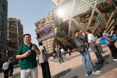 MACAU, CHINA - NOVEMBER 2, 2012  Tourists at the Grand Lisboa Casino - one of the largest and popular casino  Macau is the gambling capital of Asia and is visited by about 29 million tourists annually