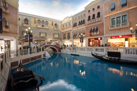 the largest: MACAU, CHINA - NOVEMBER 2, 2012: The Venetian - very famous entertainment complex includes the largest shopping mall, luxurious hotels and the largest casino in the world. Evening time.