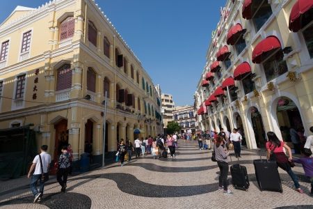 unesco world cultural heritage: MACAU, CHINA - NOVEMBER 3, 2012: Tourists visit the Historic Center of Macau. Historic Center of Macau was inscribed on UNESCO World Heritage List in 2005.