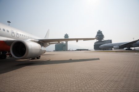 fuselage: Passenger aircraft on the runway of Hong Kong International Airport site