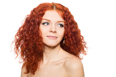 Beautiful young woman with curly red hair  photo