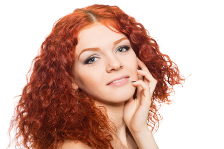 Smiling young woman with red hair   photo