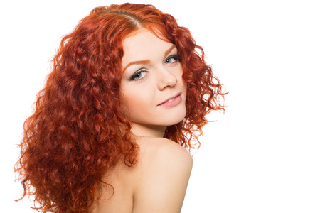 Smiling young woman with red hair isolated on white  photo