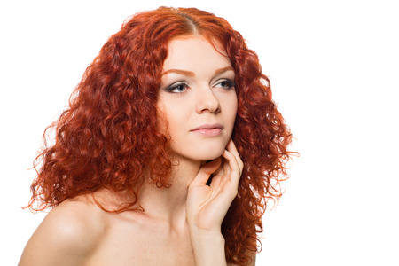 Beautiful girl with curly red hair photo