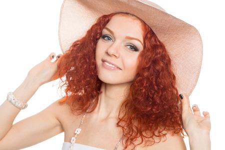 Beautiful young woman wearing a hat  photo
