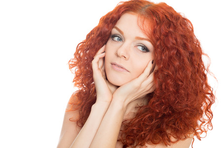 Beautiful young woman with curly red hair  Stock Photo