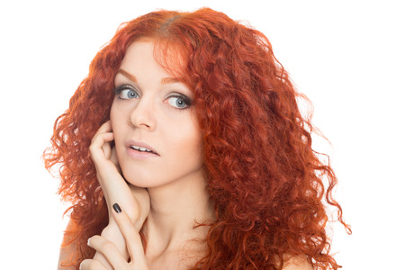 consternation: Surprised beautiful pretty girl with curly red hair