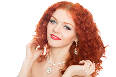 Happy girl with curly red hair isolated on white