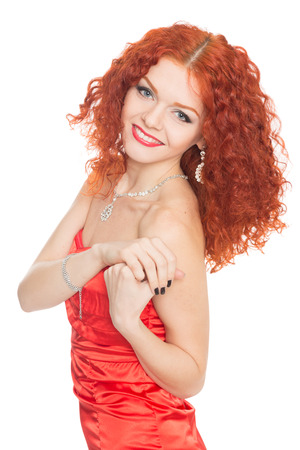 smiling young girl with red hair in a red dress   photo
