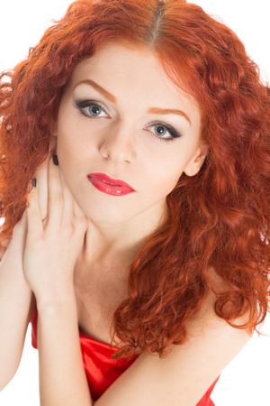 Beautiful girl in red dress with red hair  photo