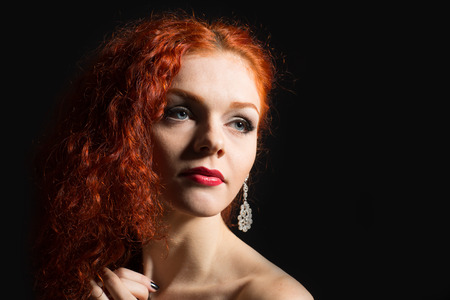 Beautiful girl with red hair  photo