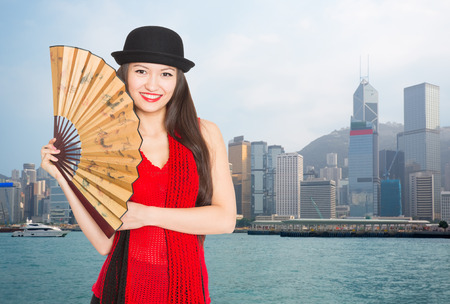 Charming smiling girl against the backdrop of Hong Kong.  photo