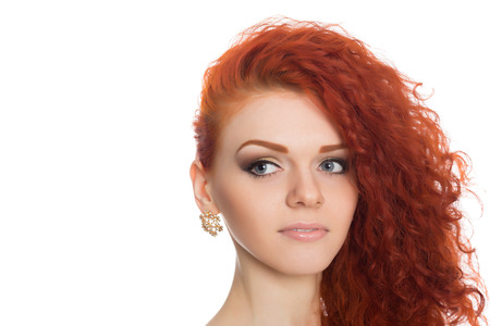 Portrait red haired young woman looking away.  photo