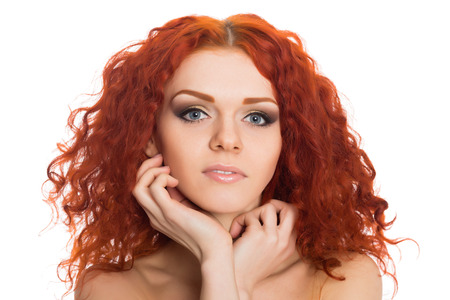 Beautiful red haired young girl with a thoughtful look.  photo