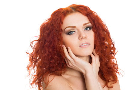 Portrait beautiful red haired young girl with a thoughtful look.  photo