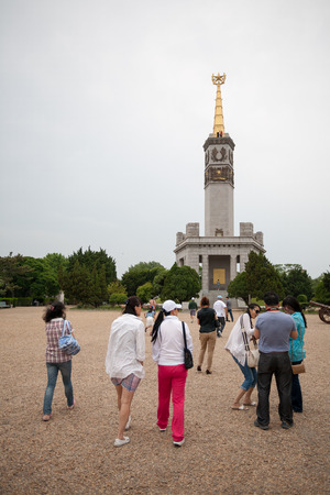 epicenter: LUSHUN, CHINA - JUNE 10, 2012: Tourists at monument to Soviet soldiers in Lushun, russian name Port Arthur, is now a naval base in China. Here was the main epicenter of the Russian - Japanese War of 1904-1905.  Editorial