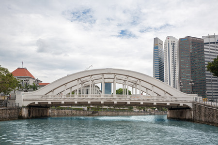 SINGAPORE - NOVEMBER 05, 2012: Elgin bridge, made in 1929, over the Singapore River in district Riverside. Bridges over the Singapore River are important in the citys infrastructure.