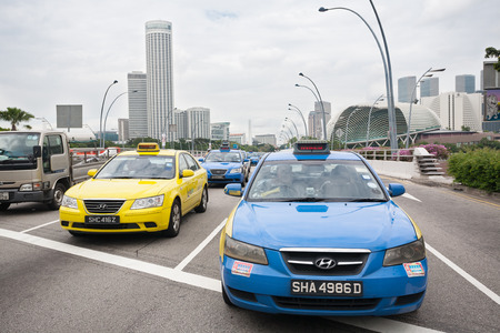SINGAPORE - NOVEMBER 05, 2012: Taxi on the Esplanade Drive. In Singapore more than 25 thousand cars involved in carting passengers, taxi is an important and popular form of public transport.