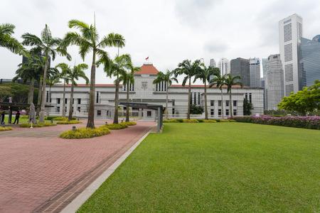 extant: SINGAPORE - NOVEMBER 05, 2012: Parliament House by the Singapore River. Built in 1827, the Old Parliament House is the oldest extant government building in Singapore.